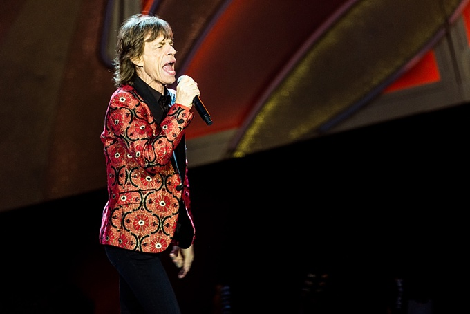 The Rolling Stones, Concert Photo, Vienna, Austria, 2014: Mick Jagger singing with red jacket on