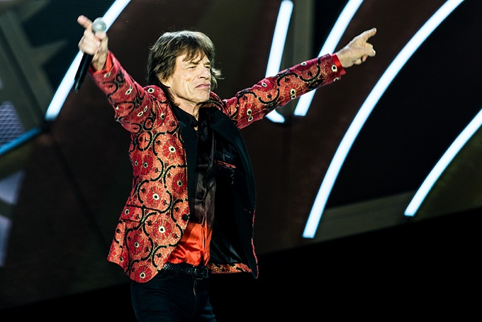 The Rolling Stones, Concert Photo, Vienna, Austria, 2014: Mick Jagger spreading hands, pointing to the sky